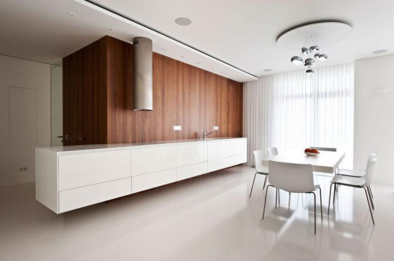 Conception d'une cuisine spacieuse dans le style du minimalisme - photo