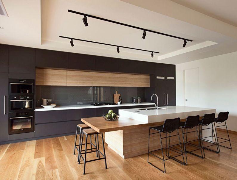Conception d'une cuisine avec îlot dans le style du minimalisme - photo