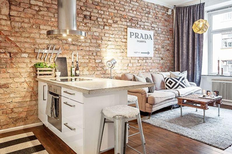 Aménagement intérieur d'une cuisine-salon dans le style loft - photo