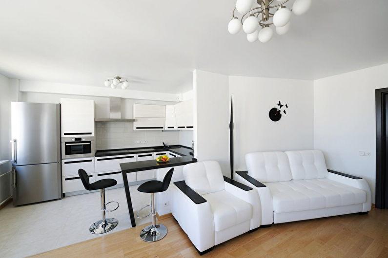 Aménagement intérieur d'un salon-cuisine blanc - photo