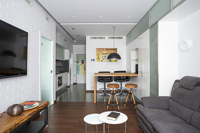 Design d'intérieur d'une cuisine-salon en blanc - photo