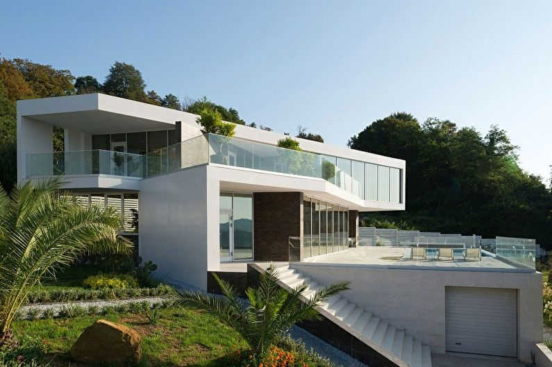 Conceptions de maisons modernes dans un style high-tech - Maison de luxe sur la pente
