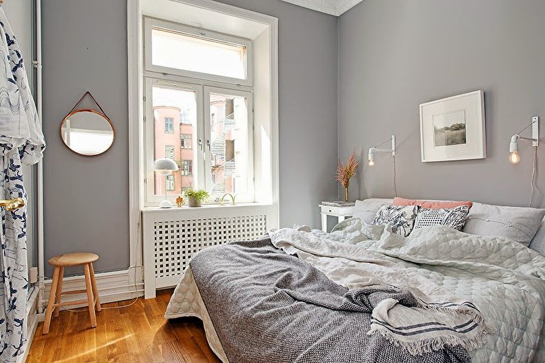 Conception d'une petite chambre dans les tons gris - photo